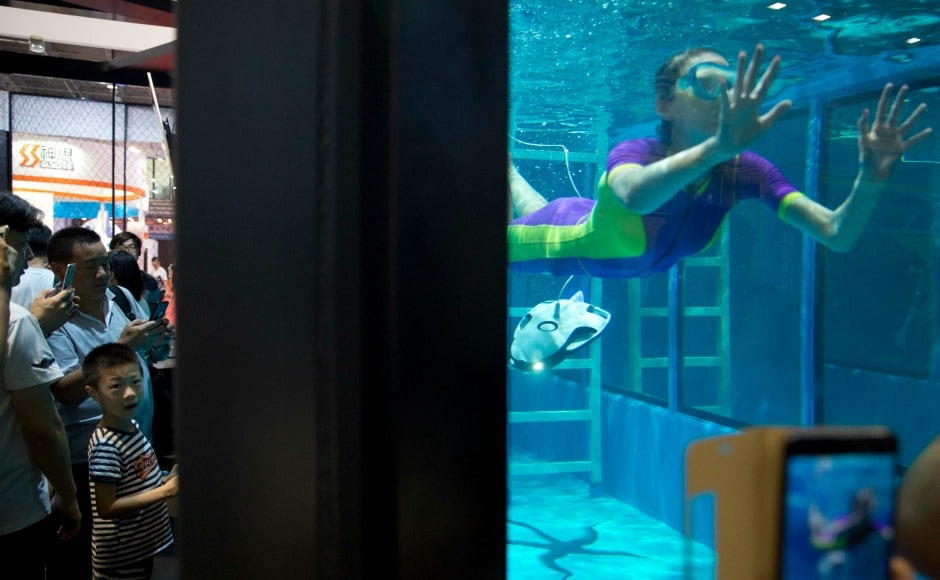 An underwater drone, an underwater robot and a life-size robot that looks like Chinese basketball star Yao Ming became highlights of the conference. AP