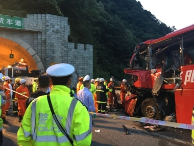 Police and firefighters work near the wreckage of the coach. Reuters