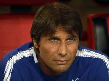 Chelsea's manager Antonio Conte watches the pregame ceremonies before the start of his team's friendly soccer match against Arsenal in Beijing, Saturday, July 22, 2017. Chelsea beat Arsenal, 3-0. (AP Photo/Mark Schiefelbein)
