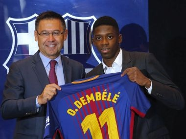 Barcelona's new signing player Ousmane Dembele, right, and FC Barcelona's president Josep Maria Bartomeu pose for the media during official presentation at the Camp Nou stadium in Barcelona, Spain, Monday, Aug. 28, 2017. Barcelona is shoring up its attack following Neymar's departure by buying Ousmane Dembele from Borussia Dortmund in a deal that could reach 147 million euros (about $173 million). (AP Photo/Manu Fernandez)