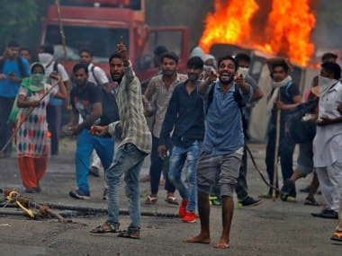 People react during violence in Panchkula, 25 August. Reuters