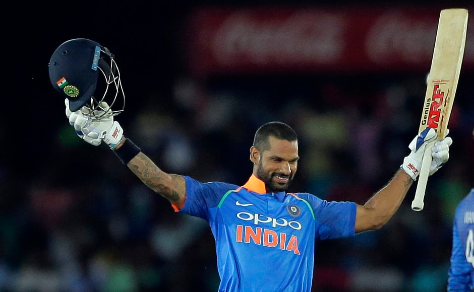India's Shikhar Dhawan raises his bat and helmet to celebrate his 11th ODI century. AP