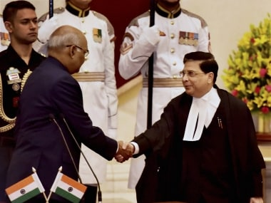 Dipak Misra with President Ram Nath Kovind at the swearing in. PTI