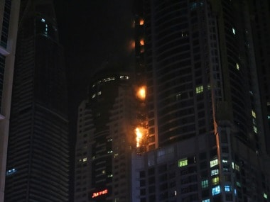 Smoke and fire rise from a high rise building at Marina district in Dubai, United Arab Emirates. AP