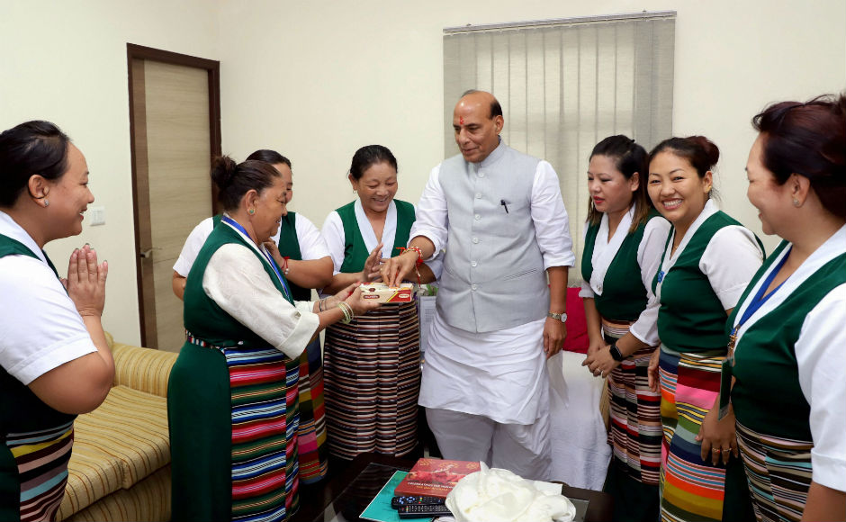 In Delhi, a group of Tibetan women tied rakhi to Home Minister Rajnath Singh at his residence. In a tweet, the home minister also greeted the country on the occasion of Raksha Bandan. PTI