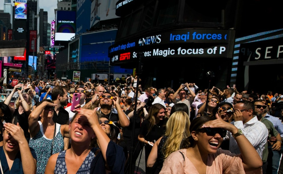 A huge crowd thronged Times Square in New York to see the crescent-shaped sun, although only 70 percent of the sun was seen covered by the moon in the city. AP