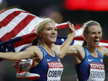 USA's Emma Coburn celebrates with compatriot and silver medal winner Courtney Frerichs, right, after winning the gold medal in the women's 3000m steeplechase final. AP