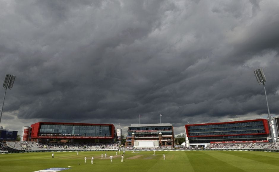 Clouds lour over the Old Trafford cricket ground as James Anderson bowls from the James Anderson end. He had Heino Kuhn edging to first slip as England picked up their 2nd wicket. AP