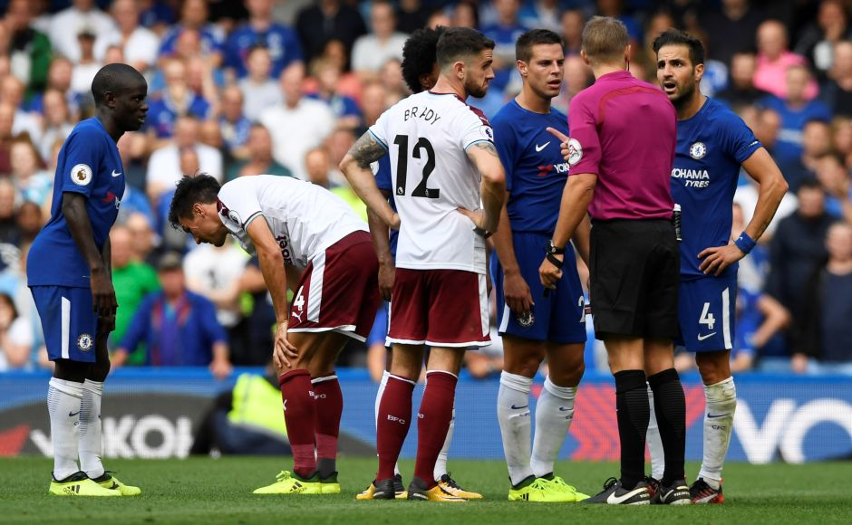 Chelsea were down to nine men as new captain Gary Cahill was sent off after only 14 minutes and Cesc Fabregas following late on. Fabregas remonstrates with referee Craig Pawson after being sent off. Reuters
