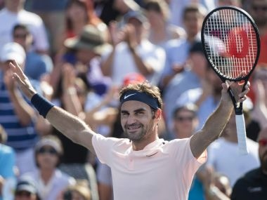 Roger Federer, of Switzerland, celebrates after defeating Robin Haase, of the Netherlands, in Rogers Cup tennis action in Montreal on Saturday, Aug. 12, 2017. (Paul Chiasson/The Canadian Press via AP)