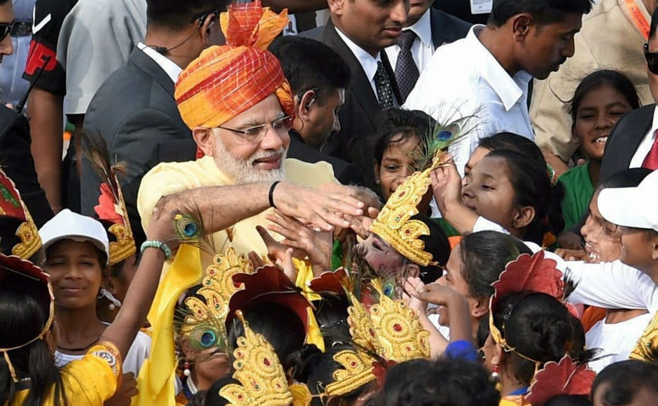 After concluding his speech, Modi interacted with children who had gathered at the Red Fort. PTI