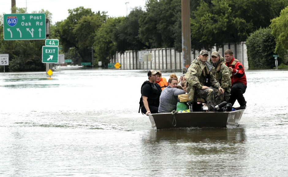 National Guard troops, police officers, rescue workers and civilians raced in helicopters, boats and special high-water trucks to rescue the hundreds of people still stranded in and around Houston. AP