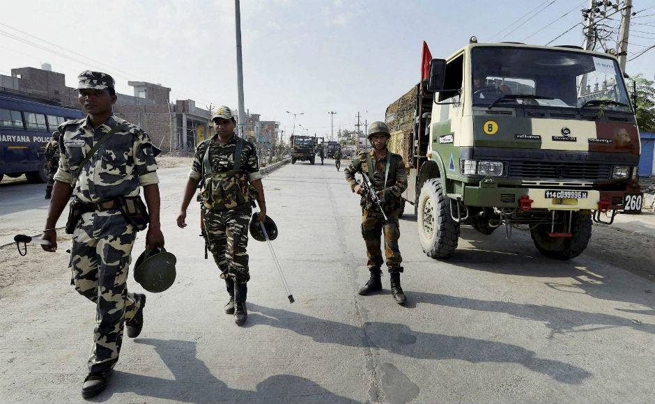 Army personnel are seen taking positions after deployment in Sirsa. An uneasy calm prevailed in Punjab and Haryana after incidents of violence on Friday left 30 people dead following the Dera Sacha Sauda chief Gurmeet Ram Rahim Singh's conviction in a rape case. No incidents of violence were reported on Saturday. PTI