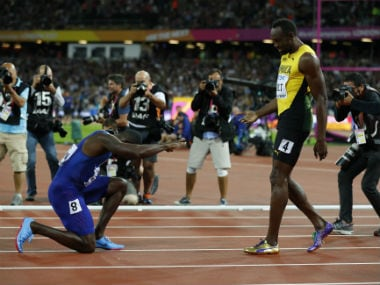 Justin Gatlin bows to Usain Bolt after stealing the thunder in 100m final in London. Reuters