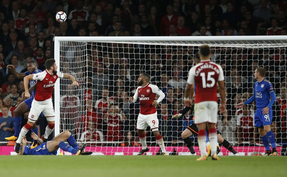 Arsenal's Olivier Giroud, left, heads the ball to score his side's fourth goal of the game in the 85th minute. The Frenchman came off the bench to secure all three points for Arsenal. AP