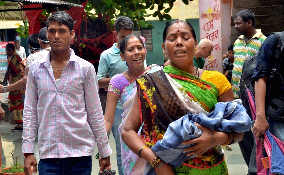 Relatives carry a child at the BRDMedical College. There has been complete panic since the news broke on Friday that several children died due to alleged non-supply of oxygen. Most parents have lost confidence in the hospital and they want to take their children home or to another hospital. PTI