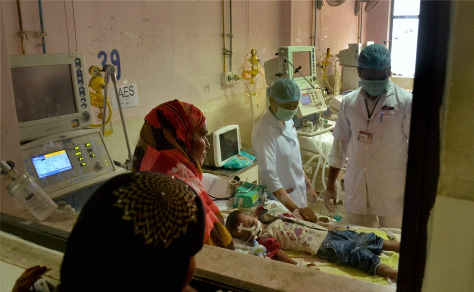 Distraught relativeslook on as children receive treatment in the encephalitis ward at the Baba Raghav Das (BRD) Medical College and Hospital where over 72 children have died over the past one week, in Gorakhpur district on Monday. PTI