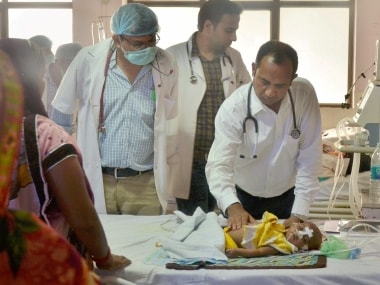 File image of a doctor examining a child at the BRD hospital in Gorakhpur. PTI
