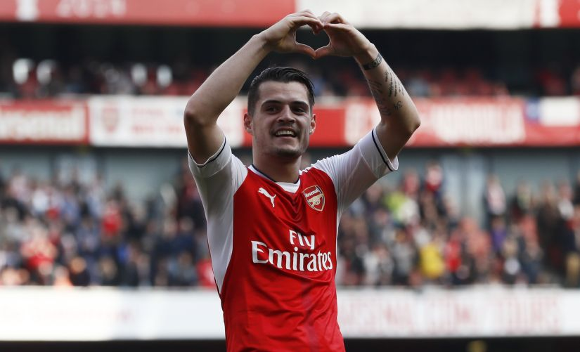 Granit Xhaka brings a lot to the table and this is his chance to step into Santi Cazorla's shoes and help Arsenal break Premier League Trophy drought. Reuters