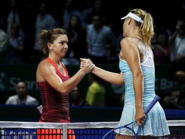 Simona Halep of Romania (L) congratulates Maria Sharapova of Russia after their women's singles tennis match of the WTA Finals at the Singapore Indoor Stadium October 27, 2015. REUTERS/Edgar Su  - RTX1TGF5
