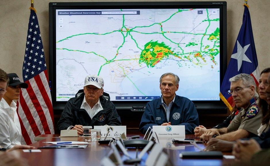 President Donald Trump visited Texas to survey damage after Hurricane Harvey lashed Houston. Tens of thousands of people fled their homes as the nation's fourth most populous city remained paralysed. AP