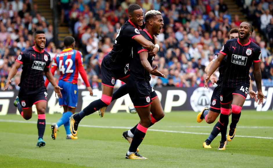 After a 45-year absence, Huddersfield Town strode back into the top flight of English football with a 3-0 win over Crystal Palace. Huddersfield Town's Steve Mounie celebrates scoring their second goal. Reuters