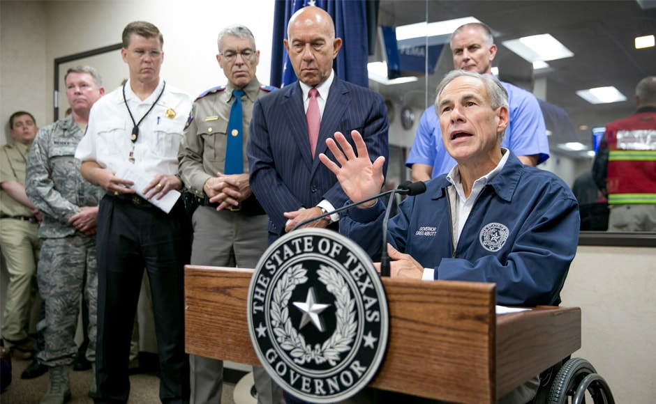 Texas governor Greg Abbott speaks at a news conference about Hurricane Harvey at the State Operations Center in Austin, Texas, on Friday. Abbot deployed more than 1,000 national guardsmen to help with evacuation and recovery. AP