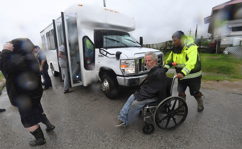 "Paramedics visited people's homes to transport disabled residents on Friday. President Donald Trump accepted Texas governor Greg Abbott's request to declare a ""major disaster zone"" in the state to speed up federal aid to millions in harm's way. AP"