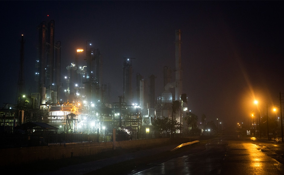 A Valero oil refinery's flare continues to burn as Hurricane Harvey made landfall in Corpus Christi on Friday. The powerful storm has forced thousands to flee their homes and crippled oil production in the Gulf. AP