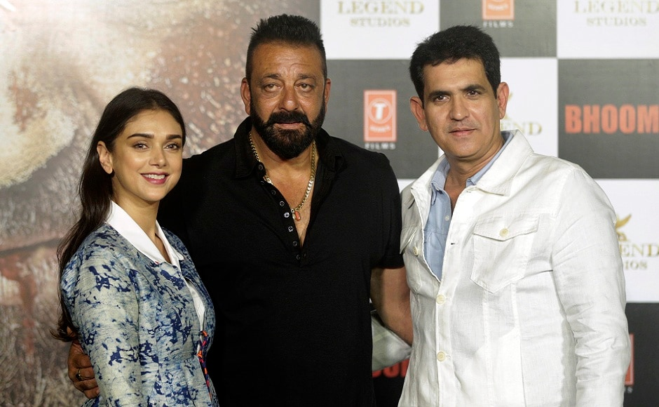 Bollywood actors Aditi Rao Hydari (left) Sanjay Dutt (center) along with film director Omung Kumar pose during the trailer launch of film Bhoomi in Mumbai, India, Thursday, 10 August, 2017. The film is scheduled for release on 22 September, 2017.  Image via AP/Rafiq Maqbool