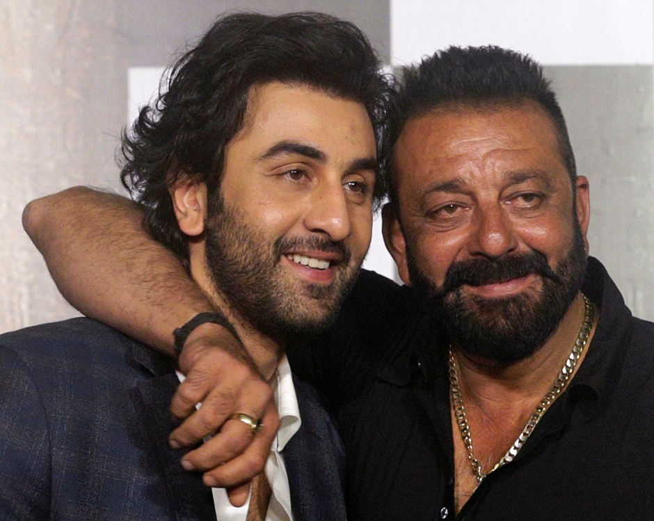 Ranbir Kapoor (left) and Sanjay Dutt pose during the trailer launch of film Bhoomi in Mumbai, India, Thursday, 10 August, 2017. Kapoor will also be seen playing Sanjay Dutt in the upcoming biopic film. Image via AP/Rafiq Maqbool