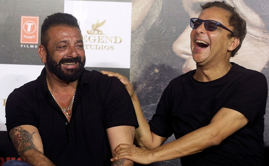 Sanjay Dutt (left) shares a light moment with Indian film director Vidhu Vinod Chopra during the trailer launch of film Bhoomi in Mumbai, India, Thursday, 10 August, 2017. Both Dutt and Chopra have collaborated many times in the past, most notably in the Munnabhai films. Image via AP/Rafiq Maqbool