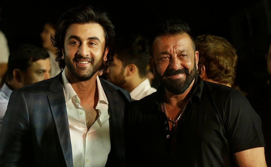 Ranbir Kapoor (left) and Sanjay Dutt arrive for the trailer launch of film Bhoomi in Mumbai, India, Thursday, 10 August, 2017. Image via AP/Rafiq Maqbool