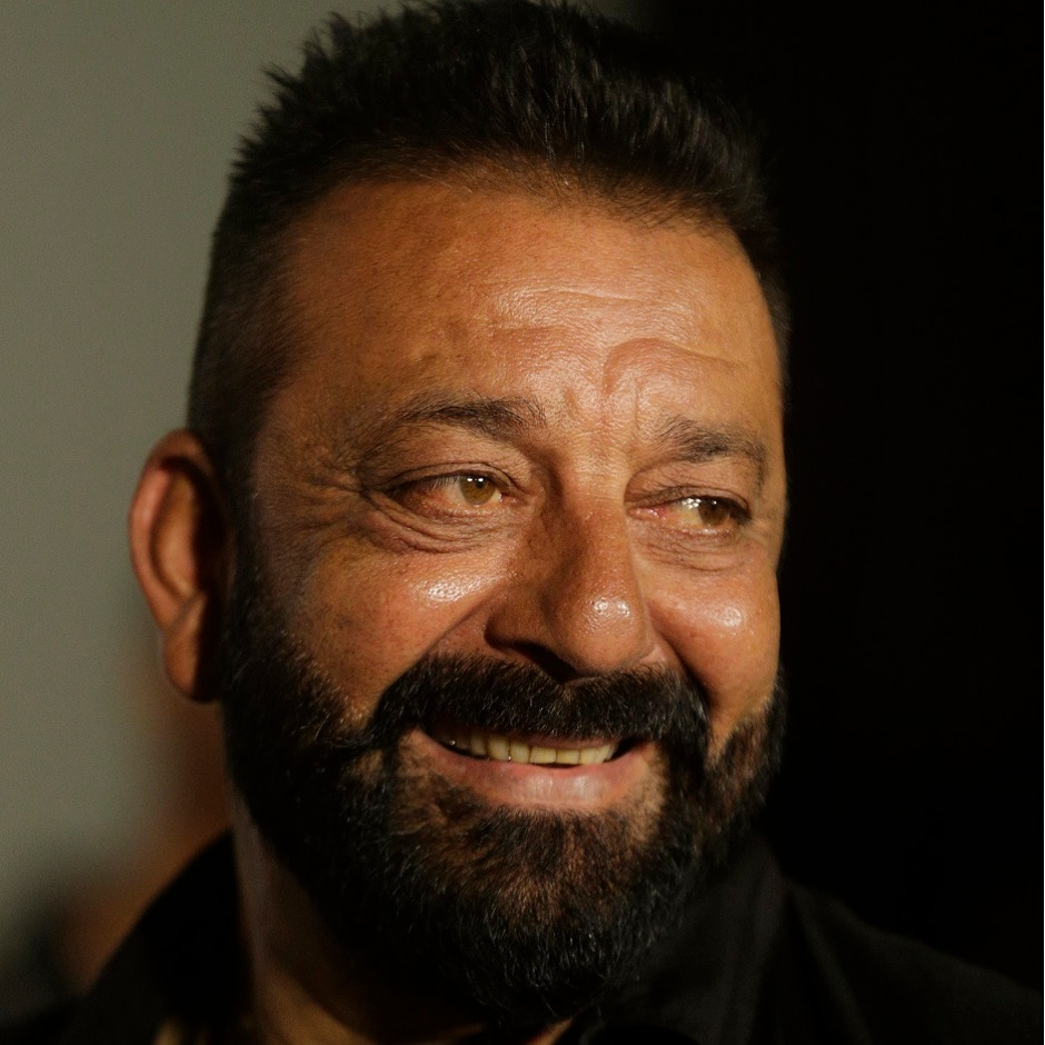 Sanjay Dutt smiles as he arrives for the trailer launch of film Bhoomi in Mumbai, India, Thursday, 10 August, 2017. This will be his first film after he got released from jail. Image via AP/Rafiq Maqbool
