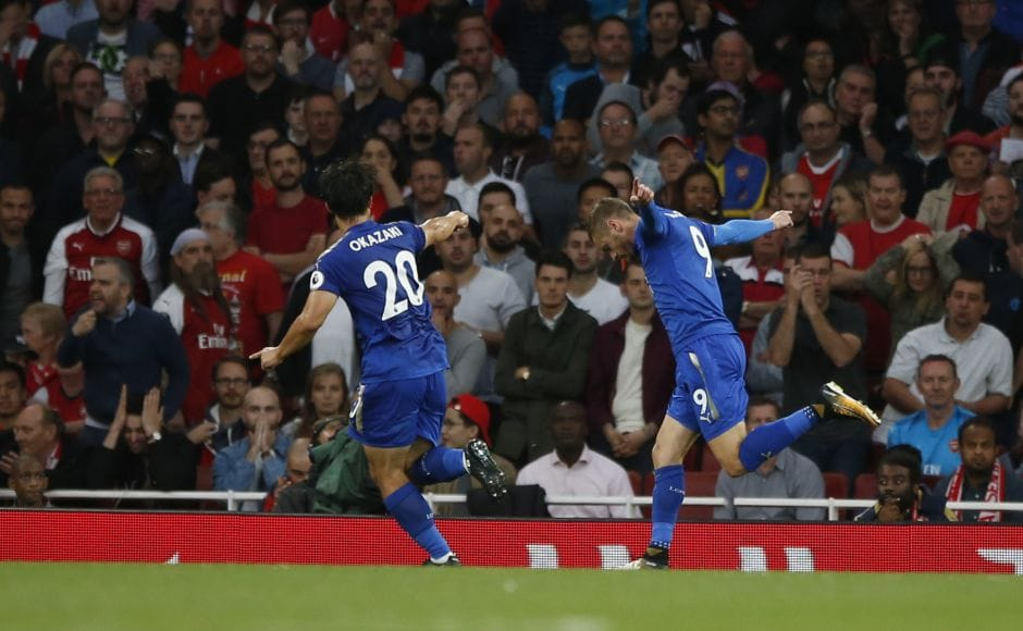 Leicester City's Jamie Vardy, right, celebrates after he scores his sides second goal of the game during their Premier League match. AP