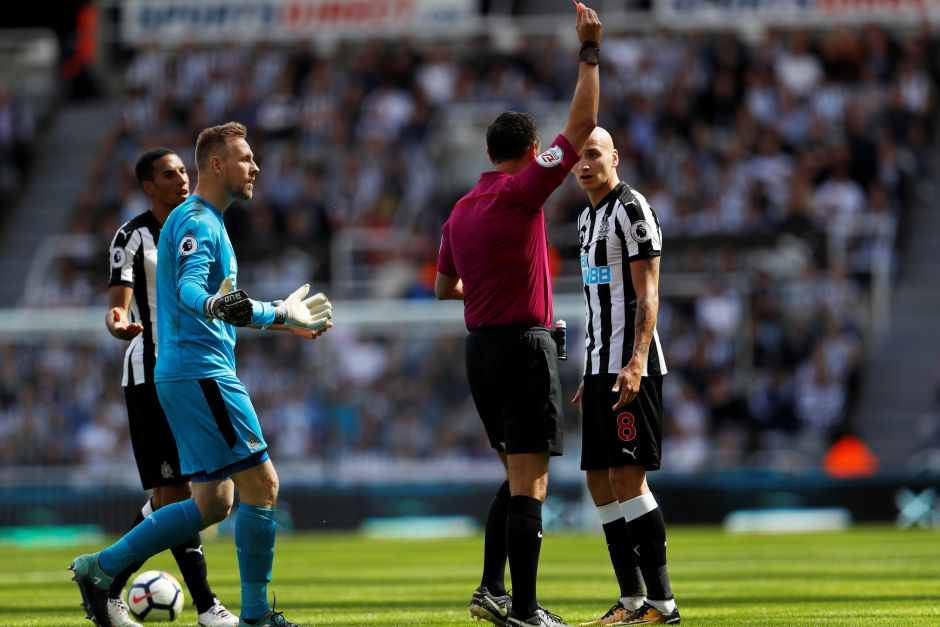 Referee Andre Marriner shows Newcastle United's Jonjo Shelvey a red card for a stamp on Tottenham's Dele Alli Action. Reuters