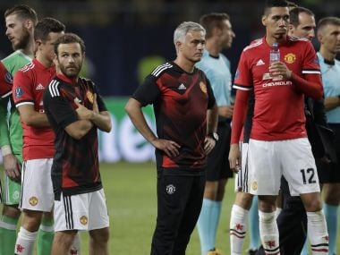 Manchester United's coach Jose Mourinho stands with some of his players after the Super Cup final soccer match between Real Madrid and Manchester United at Philip II Arena in Skopje, Tuesday, Aug. 8, 2017. Real Madrid defeated Manchester United 2-1. (AP Photo/Thanassis Stavrakis)