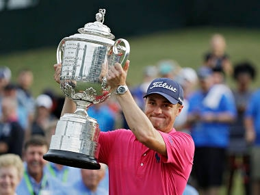 Justin Thomas poses with the Trophy after winning the PGA Championship. AP