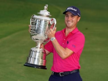 Justin Thomas celebrates with the Wanamaker Trophy after winning the 2017 PGA Championship. Reuters