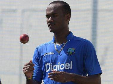 West Indies' cricketer Kraigg Brathwaite tosses the ball as he prepares to bowl during a practice session at the Sharjah Cricket Stadium in Sharjah on October 28, 2016, ahead of their third and last Test match against Pakistan on October 30. / AFP PHOTO / AAMIR QURESHI