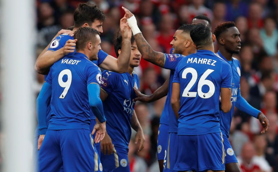 Leicester City's Shinji Okazaki celebrates scoring their first goal with teammates. Arsenal's lead lasted three minutes before Leicester's new signing Harry Maguire headed Marc Albrighton's cross from the left back into the middle and Okazaki nodded the ball past flailing Arsenal goalkeeper Petr Cech. Reuters