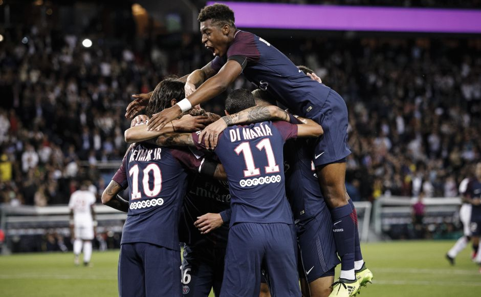 PSG's Presnel Kimpembe, jumps to his team mates, after PSG's Adrien Rabiot scored against Toulouse. Rabiot played a quick one-two with Neymar and drilled in a superb low shot into the bottom left corner from 20 metres out. AP
