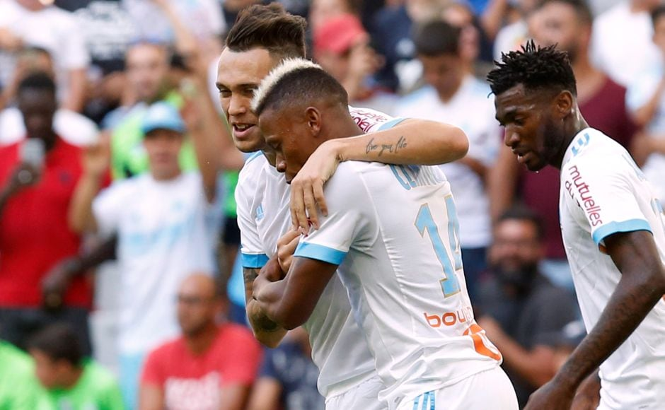 Marseille drew 1-1 at home to Angers. Clinton Njie made it three goals in three games to put Marseille ahead in the 17th minute but striker Karl Toko Ekambi equalized for Angers in the 71st. Reuters