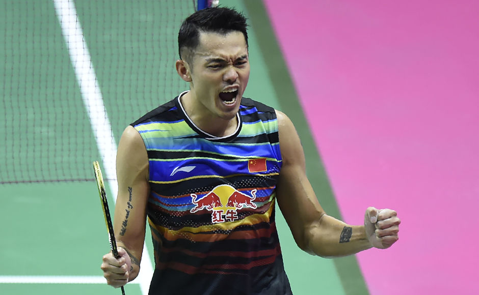 China's Lin Dan was also a happy man as he won against Denmark's Emil Holst in their round two mens's singles match. AFP