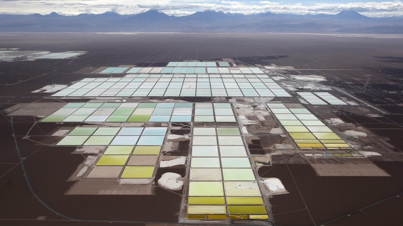 An aerial view shows the brine pools and processing areas of the Soquimich (SQM) lithium mine on the Atacama salt flat. Image Credit: Reuters