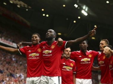 Romelu Lukaku celebrates with his teammates after scoring his debut goal for Manchester United. AP