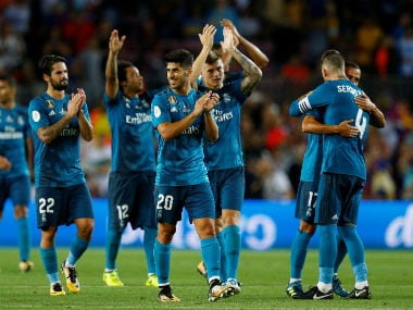 Real Madrid's Marco Asensio celebrates with teammates after the match. Reuters
