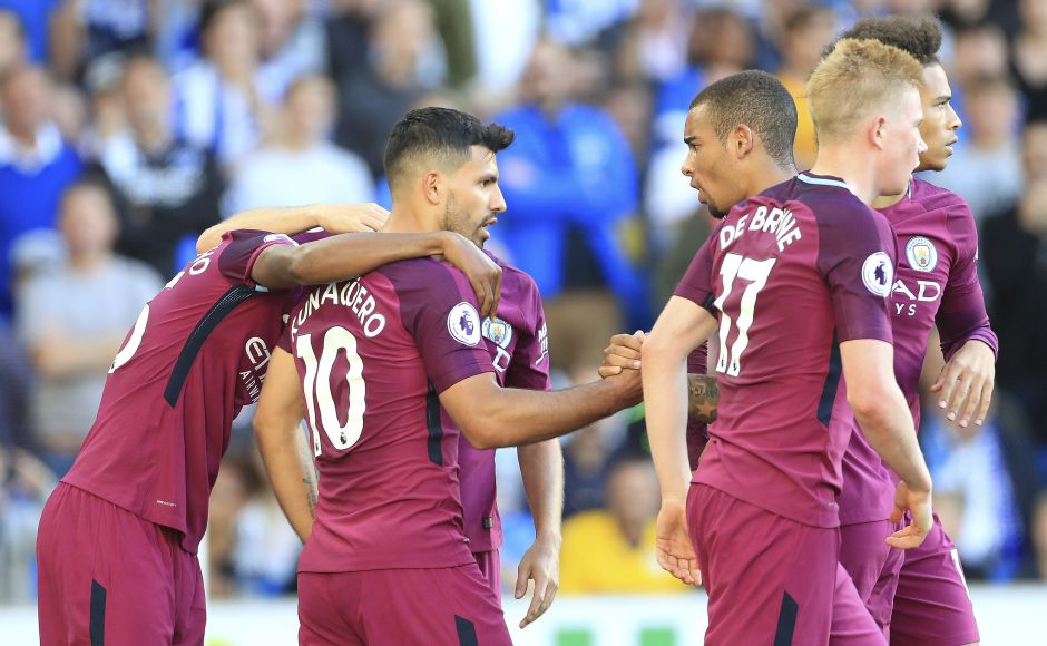 Manchester City's Sergio Aguero, centre, celebrates scoring his side's first goal teammates. Brighton defender Lewis Dunk slammed a header into his own net as he tried to clear a cross under pressure from Gabriel Jesus, with the home side lacking the firepower to mount a comeback in the closing stages. AP