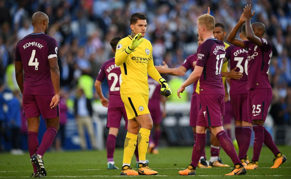 Manchester City's Ederson Moraes celebrates after the match with Kevin De Bruyne. Reuters