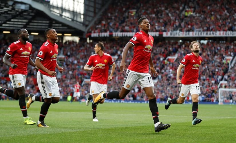 "Football Soccer - Premier League - Manchester United vs Leicester City - Manchester, Britain - August 26, 2017   Manchester United's Marcus Rashford celebrates scoring their first goal with teammates   Action Images via Reuters/Carl Recine    EDITORIAL USE ONLY. No use with unauthorized audio, video, data, fixture lists, club/league logos or ""live"" services. Online in-match use limited to 45 images, no video emulation. No use in betting, games or single club/league/player publications. Please contact your account representative for further details. - RTX3DG3A"